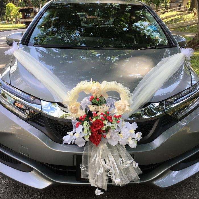 عکس تزیین ماشین عروس با تور